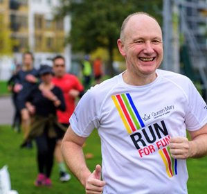 Principal Colin Bailey jogging in a t-shirt that reads 'Run for Fun'